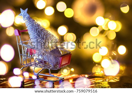 buying a shiny christmas tree in a metal trolley