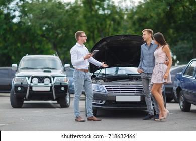 Buying used car. Car Dealer Inventory. Used cars store. Male wants to buy the car. Happy life. Summer time. Young family. Communication with the seller from auto for sale.