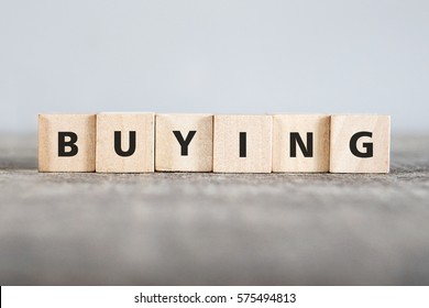 BUYING word made with building blocks