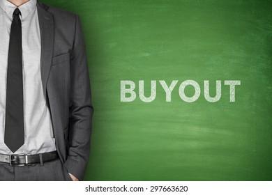 Buyout word on green blackboard with businessman