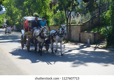 Buyukada, ISTANBUL, TURKEY - 12 MAY 2018: Traditional coaches are carrying people. Coach horses and coachmans in Princes' Islands Buyukada, Istanbul,Turkey. Cars are not allowed in the island
