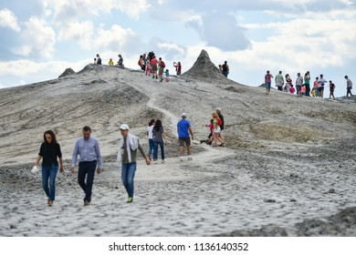 BUZAU, ROMANIA - AUGUST 13, 2016: Groups of tourists visiting mud volcanoes also known as mud domes in summer season.
