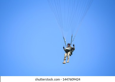 Buzau, Romania - May 22, 2019: Military paratroopers jump from an Alenia C-27J Spartan military cargo plane.