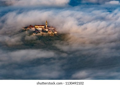 Buzet old town, Croatia over morning clouds. Fairy tale landscape of famous tourist destination.