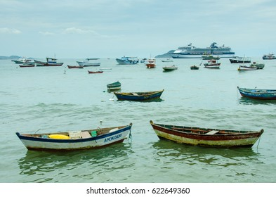 BUZIOS, BRAZIL – FEBRUARY 25, 2017: Fishing boats at anchor in the harbor of the resort city on the Atlantic coast including a dory-like boat popular with local fishermen.