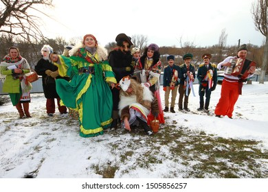 Buzovytsia, Ukraine - January 13, 2018: Ancient pagan ritual of Malanka (Malanca), performed by unmarried youth. Wild Ukrainian carnival. Boys and girls in costumes of Goat, Gypsy, Doctor and Cossack.