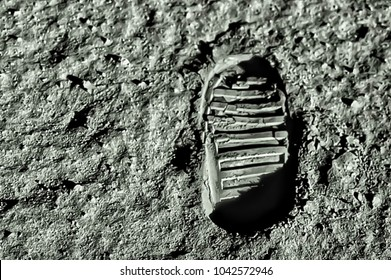 Buzz Aldrin's footprint on the moon. Astronaut's boot print on lunar moon landing mission. Moon Surface. Image of the Moon showing landing site of Apollo 11. Elements of this image furnished by NASA