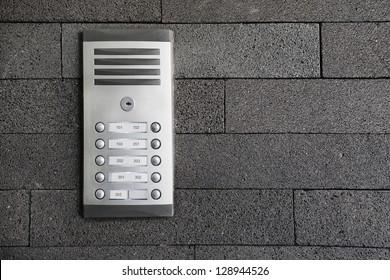 Buzzer on a grey stonewall