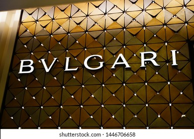 BVLGARI (Bulgari) logo brand neon sign shop store at Siam Paragon shopping mall. Bangkok, Thailand. 7 July 2019.