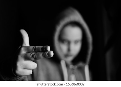 B&W image of gangster kid with finger gun pointed in camera