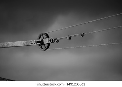 B/W mechanical pully with storm clouds