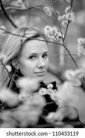 b/w portrait of a girl with flowers