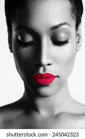 bw portrait of a woman with a bright colored lips