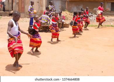 Bwaise, Kampala, Uganda - October 4 2018: Street children from the slums of Kampala, raised by passionate teachers, performing art and dance on authentic Ugandan folk music. Stichting Bulamu 2018
