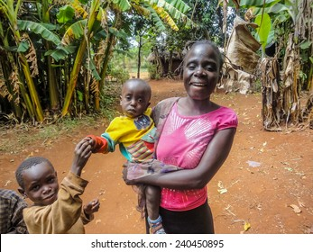 BWAYI, KENYA - FEBRUARY 11, 2014: Unidentified family at Bwayi, Kenya. Bwayi is Bwayi, a rural farming village outside of Kitale, Kenya.