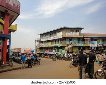 BWAYI, KENYA - FEBRUARY 13, 2014: Unidentified people on the street of Kitale, Kenya. Kitale is an agricultural town in western Kenya at an elevation of around 1,900 metres.