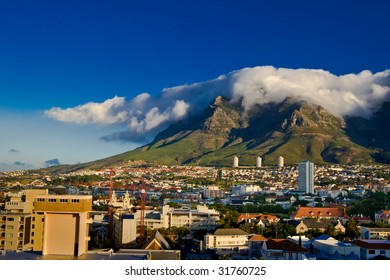 By a beautiful summer, a big cloud has formed on the Table Mountain in Cape Town, South Africa.