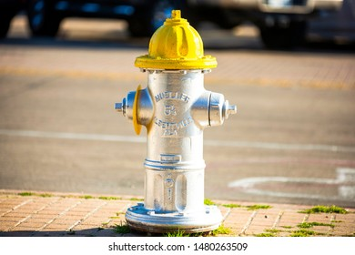 by the corner of the street yellow top fire hydrant