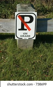 By order of the Department of  Environmental Protection, No Parking on the Grass sign.