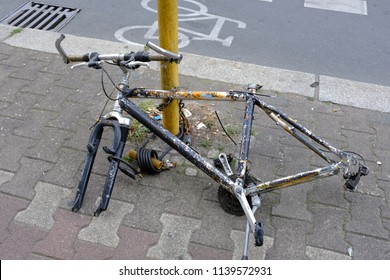 A by thieves decomposed bicycle on a pathway in Berlin-Germany.