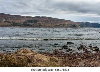 By the Water. Wild, rugged landscape of Loch, beach and hills. Loch Ness, Highlands, Scotland, UK