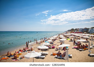 BYALA, BULGARIA -AUGUST 15: Crowded beach with tourists in summer on August 15, 2012 in Byala, Bulgaria. The number of foreigners, visiting Bulgaria in August 2012, amounted to 1 637 thousand people.