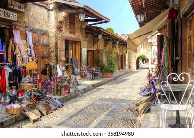 BYBLOS, LEBANON - 13 August, 2013: A view of the old pedestrian souk in Byblos, Lebanon during the day. A very medieval and picturesque area,  paved with little stones and with little shops.