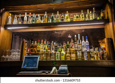 BYBLOS, LEBANON - August 2017: Bar counter with a lot of bottles with alcohol at one of Byblos bars, Lebanon