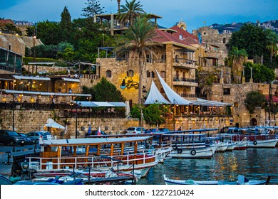 BYBLOS, LEBANON - October 2018: Historical houses and boats in the old port of Byblos, Lebanon