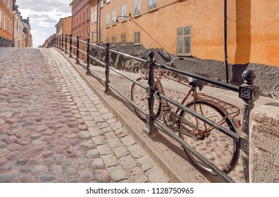 Bycicle on old street with cobbled stones and colorful historical houses. Cityscape of Stockholm, Sweden