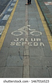A bycycle lane in a city in Indonesia. Jalur sepeda means bycycle lane.