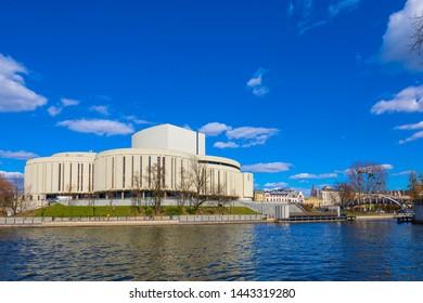 Bydgoszcz, Kujavian-Pomeranian / Poland - 2019/04/01: Opera Nova - Pomeranian Philharmonic modernistic music theater on the Brda River bank, in the Bydgoszcz historic quarter