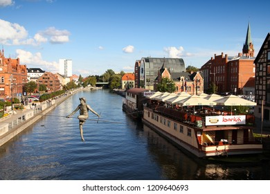 BYDGOSZCZ, POLAND - SEPTEMBER 4, 2010: People visit riverfront in Bydgoszcz. Bydgoszcz is the capital of region Kujawsko-Pomorskie visited by 2.25m tourists annually (2008).