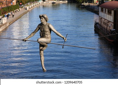 """BYDGOSZCZ, POLAND - SEPTEMBER 4, 2010: Statue """"Crossing the River"""" in Bydgoszcz. Artwork authored by Jerzy Kedziora is a known landmark since 2004."""