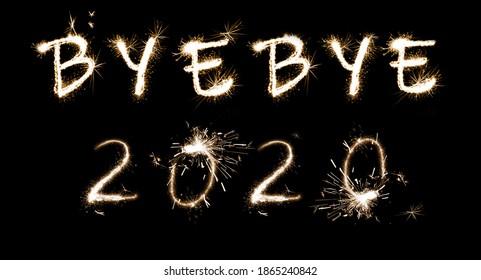 Bye Bye 2020. Bright text made of sparkler on black background, banner design