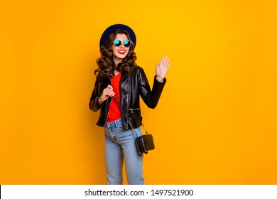Bye-bye wonderful city! Photo of pretty lady leaving home saying good-bye foreign friends wear stylish outfit with shoulder clutch isolated yellow background