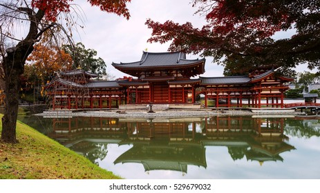 Byodo-in's Phoenix hall with autumn colors in Uji, Kyoto, Japan. Here is the most famous Uji landmark jointly with temples of the Jodo-shu and Tendai-shu sects.