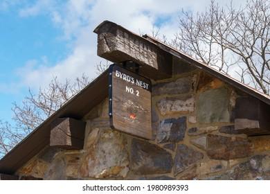 Byrds Nest cabin signpost hanging from large beam, in Shenandoah National Park