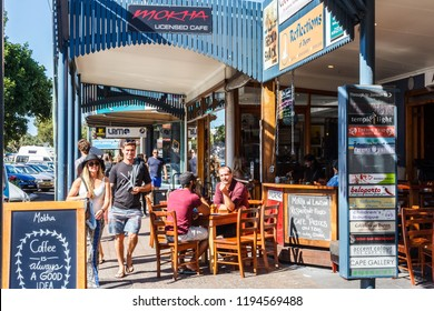 Byron Bay, Australia - 14th May 2015: People walking past and sitting in coffee shop. The town is popular with young people.