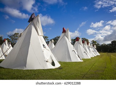 BYRON BAY, AUSTRALIA - APRIL 12 :Rainbow Tipi Village at the 2017 Byron Bay Bluesfest. 28th annual Blues and Roots festival. Field of white tipi tents. Camping festival accommodation.