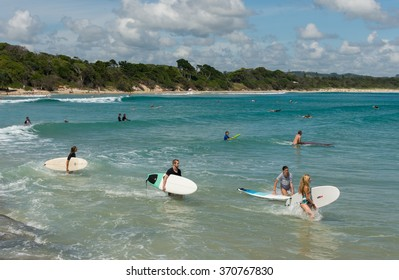 BYRON BAY, AUSTRALIA â?? JANUARY 26, 2016: Surfers looking for waves in the beach of Byron Bay.