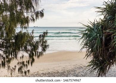 BYRON BAY, AUSTRALIA - SEPTEMBER 20, 2014: Surfer riding a wave at Wategos Beach Byron Bay, NSW, Australia