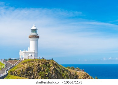 Byron Bay, NSW, Australia- January 3, 2018: Ocean view over Cape Byron lighthouse, the Most Easterly Point on the Australian Mainland in Byron Bay, Australia. Unidentified tourists in the background.