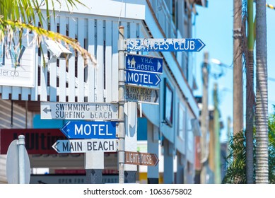 Byron Bay, NSW, Australia- January 3, 2018: Touristic guidance directional signs on pole in Byron Bay, a paradise with gorgeous beaches and coastal trails on the North Coast of NSW, Australia.