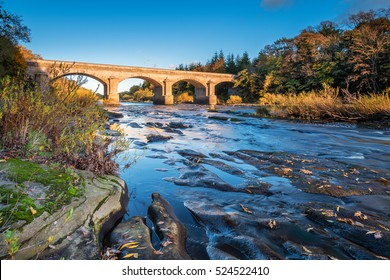 Bywell Bridge crosses River Tyne / The River Tyne flows through Northumberland, under the stone arched Bywell Road Bridge near Stocksfield
