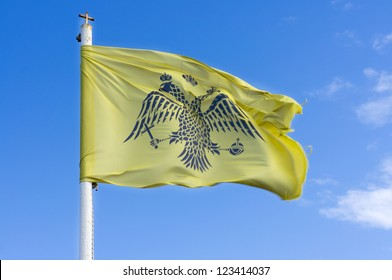 Byzantine flag under blue sky isolated