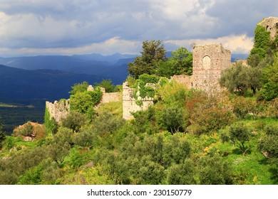 Byzantine ruins of the medieval city of Mystras under gloomy sky, Greece