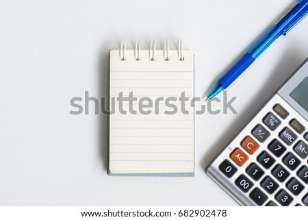 C Notepad Pen Calculator On White Table Using Wallpaper Or Background For Note