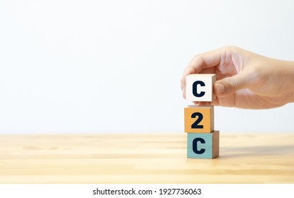 C2c concepts with text person hand putting wood block.business strategy or planning management