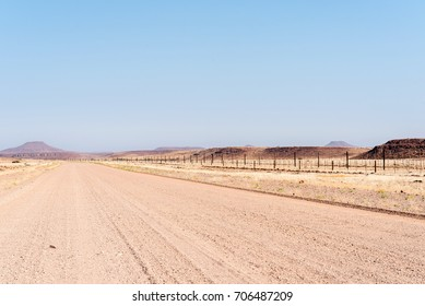 The C39-road between Dopsteekhoogte Pass and Torra Bay, in the Kunene Region of Namibia. The Red line, a veterinary fence, is to the right